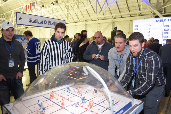 Dufferin Concrete Employees at the Bubble Hockey
