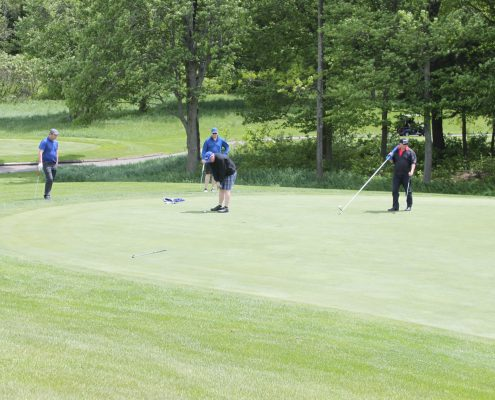 4 Customers and employees playing golf during the Dufferin Concrete Golf Fundraiser Tournament Camp Ooch