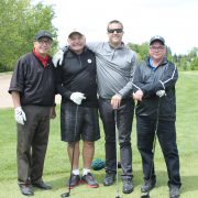 Four employees on the golf course at the Dufferin Concrete Golf Fundraiser Tournament