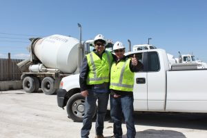Two employees smiling together at the Dufferin Concrete plant