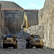 Two trucks carrying rocks in the Niagara tunnel projects
